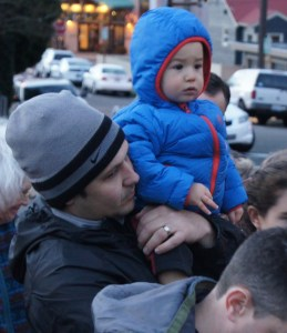 A father and son watch the event.