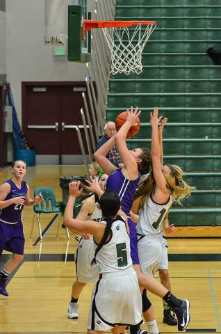 Sidney Eck, fighting for a rebound, had a double-double Friday night. (Photos by Karl Swenson)