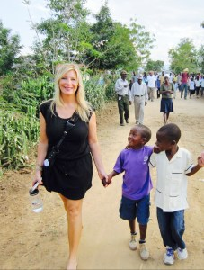 Pur Skin founder Denice Schwind with Haitian children.