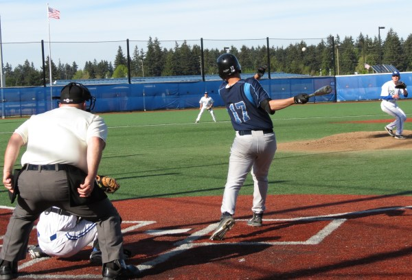 Meadowdale's Jacob Hunnewell hits a single against Shorewood Wednesday. (Photo by Marshall Reese)