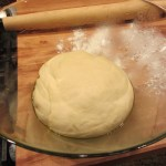 Once the dough has doubled in size it's time to roll it out. I find that this recipe will easily make two personal size pizzas...but this night I made a small one and two bigger ones.