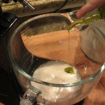After the mixture is nice and foamy, add the extra virgin olive oil and the kosher salt. (Do not add the salt when you add the sugar, it will stop the yeast from blooming.)