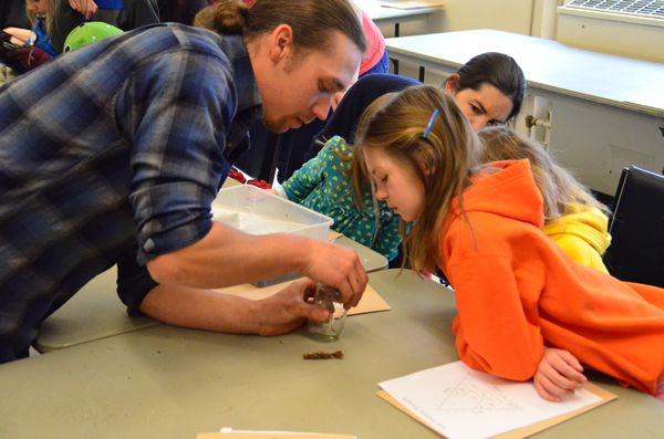 Matt Erwin from Farmer Frog explains to Shorewood Elementary Third-grader Paige Oliver the differences between millipedes and centipedes, two common garden pests.