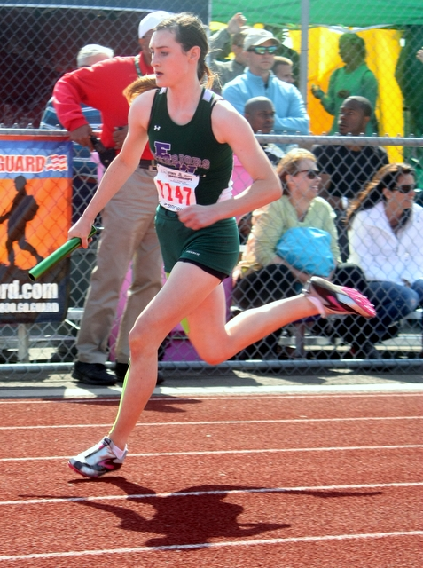 Edmonds-Woodway's Ella Spillane runs the first leg of the 400 relay.