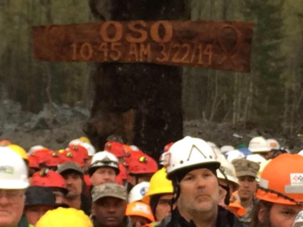 A sign on the site commemorates the date and time of the massive mudslide that took more than 40 lives and left a mile-long swathe of destruction just east of the town of Oso.