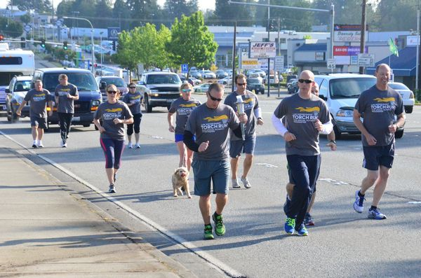 The Edmonds Police Department team pounds the pavement on the two-and-a-half- mile leg of Highway 99 between 212th Street Southwest and the county line, all part of the Law Enforcement Special Olympics Torch Run. (Photos by Larry Vogel)