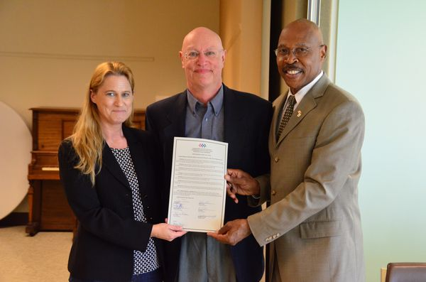 County Council President Stephanie Wright and County Executive John Lovick present Edmonds Senior Center Executive Director Farrell Fleming with a copy of the Joint Resolution 14-011 commending the Edmonds Senior Center and endorsing the construction of a new center.