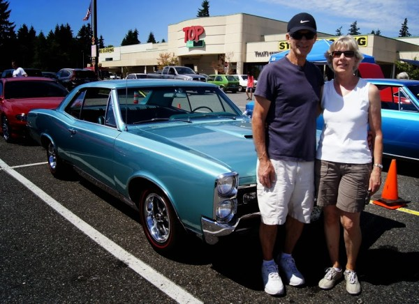 "Terry and Ruth Taylor, of Edmonds, with their pristine Pontiac GTO, which they bought brand new back in 1967. Terry bought it for the 360 horsepower, and Ruth bought it for the power brakes, power steering and automatic transmission. It has only 50,000 miles. ""Terry purchased it for just under $4,000, and when I took out my wallet and asked, ""How much would you take for it now?"" he said 35, "" Carlos said. ""To which Ruth quickly said, 'No!' It's been such a part of their lives she doesn't want to sell it. Luckily, I didn't have $35,000 anyway."
