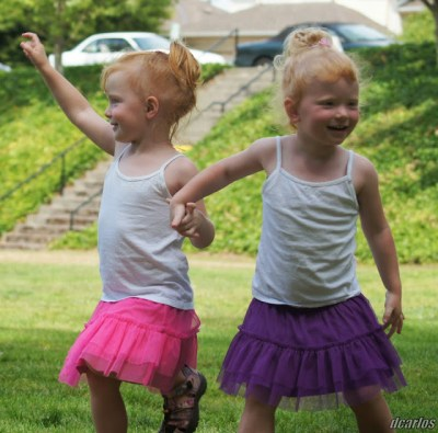 Twins Angela and Samantha of Edmonds dance to the 85th Street Band Sunday afternoon at City Park. (Photos by David Carlos)