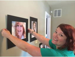 Amy Gentry hanging photos in the salon.