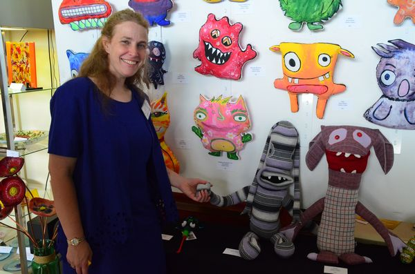 Heather Halder creates whimsical creatures that add notes of fun and playfulness to your home.  Here she holds hands with one of her creations, George the Closet Monster.