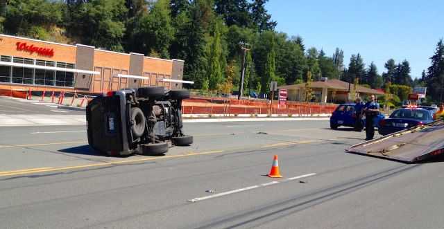 This Toyota 4 Runner flipped on its side in the center turn lane on Edmonds Way in front of Walgreens just before noon Sunday. According to officer Brad Paulson, the SUV collided with a Toyota Yaris at low speed, pulling the bumper off the smaller car and resulting in minor injuries to the driver. Traffic was diverted around the scene for about 45 minutes.