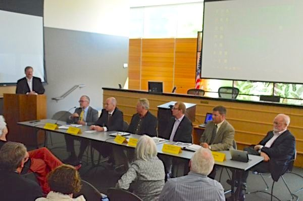 The panel brought together experts on all side of the issue.  Moderated by Snohomish County Councilmember Dave Sommers (standing), the panel was comprised of (L to R) Ross Macfarlane of Climate Solutions, Sightline Institute Policy Director Eric de Place, BNSF Consultant Terry Finn, Joe Ritzman of SSA Marine, Sean Ardussi of Puget Sound Regional Council, and Edmonds Mayor Dave Earling.