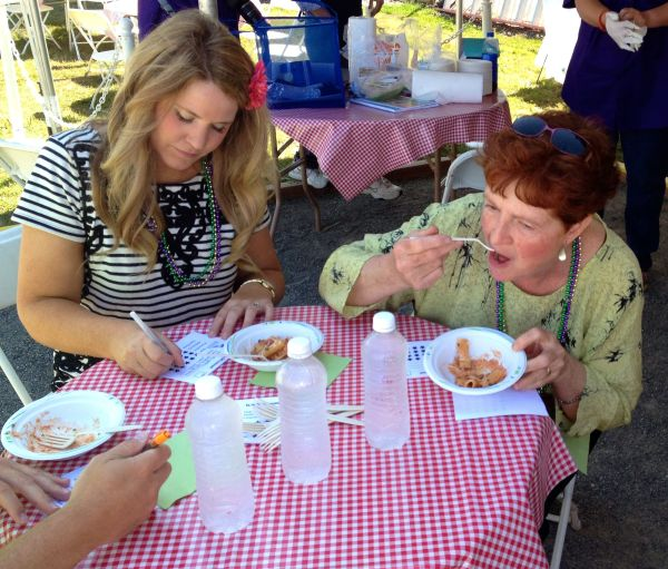 Tasteoff judges Courtney Generaus from ServPro and Kathy Passage, My Edmonds Restaurant News columnist, taste the Rigatoni Bolognese.