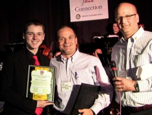 In 2015, Ryan Leppich from Mountlake Terrace High School was awarded a $2,000 scholarship from Jazz Connection Chairman Chris Lindberg, far right, and Daybreakers member and sponsor Jamie Reece. (Photo by Larry Vogel)