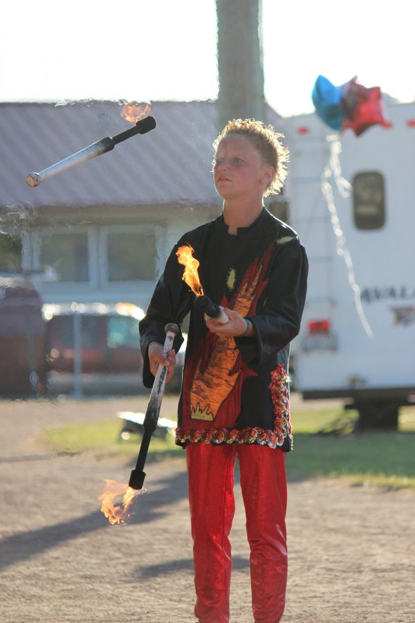 Tristyn Geren, 14, juggles fire. (Photos courtesy Wenatchee Youth Circus)