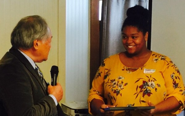Renee Brown (right), a junior at Meadowdale High School, received the Student of the Month Award from Richard Okimoto at the Tuesday, Oct. 18 meeting of the Edmonds Rotary Noon Club.  Her teachers praised her for being such a positive force in the student body.  Brown has dreams of  becoming a women's health care practitioner and helping women in developing countries. (Photo courtesy Edmonds Rotary Noon Club)