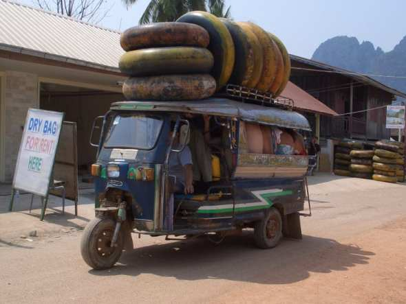 Tubes on top of a tuk tuk in Laos