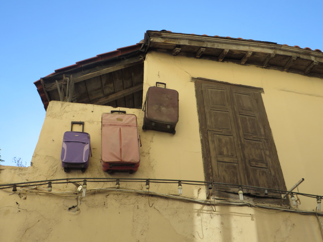 Luggages hanging on a wall!