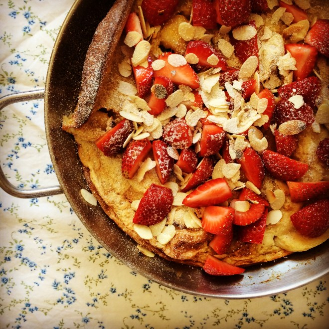 caramelised banana dutch pancake with fresh strawberries