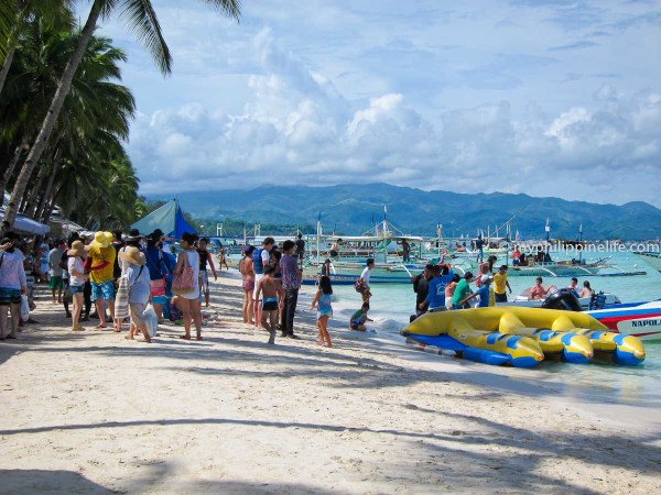Boracay can be crowded.  People queuing for boat rides.