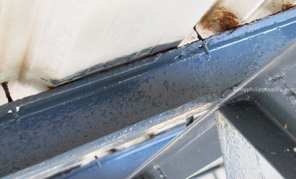 Roof corrosion in open garage.