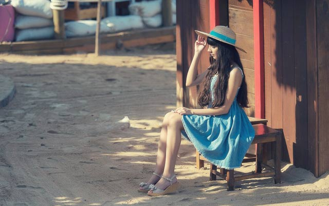 Girl in a blue dress outdoor portrait photography