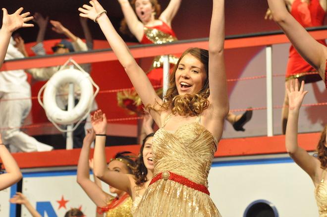 "Chorus member Emily Ustianowski sings ""Blow Gabriel, Blow"" in Burlington High School's production of ""Anything Goes."" (Photo by Ed Nadolski)"