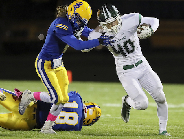 Nolan Weber (40) busts off a tough run for Waterford last Friday. The Wolverines will look to play smashmouth football against Badger. If Waterford wins, it will share the SLC title. (Rick Benavides/SLN)