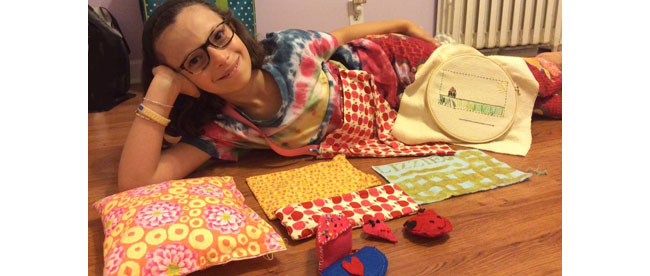 Lizzie showing off what she made at sewing camp