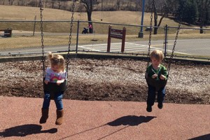 twins-swinging-playground