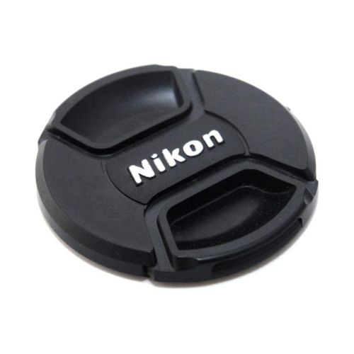 Medium Crop Of Nikon Lens Cap