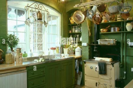 batterie de cuisine above cream aga oven in traditional green kitchen e88pkw