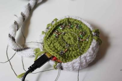 The centre crocheted part of the radio that houses the lilypad and other small components