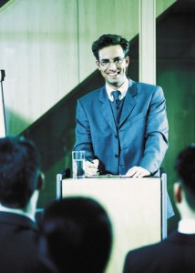 Businessman lecturing - hombre hablando en publico