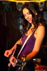 Natasha Blasick on bass guitar live with Snowflakes
