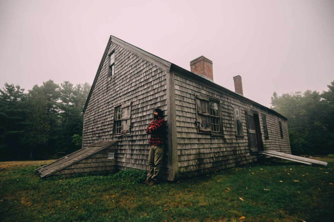Andres in front of an old homestead in Acadia, where early settlers lived off the land.