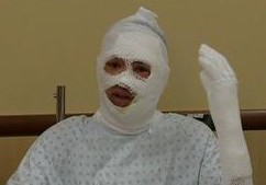 Nigel Covington Waves for the Camera While Recovering in the Hospital