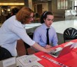 Town Hall representative Helen Andronaco assists junior Robert Hoover with his online registration. Photo by Rosemary O'Neill