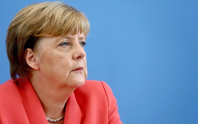 German Chancellor Angela Merkel looking to the left