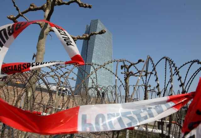 Police tape and barb-wire in front of European Central Bank