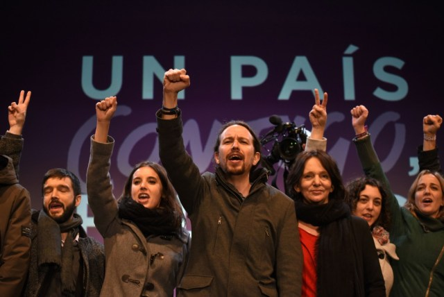 Pablo Iglesias and Podemos political party members celebrate elction results with raised fists