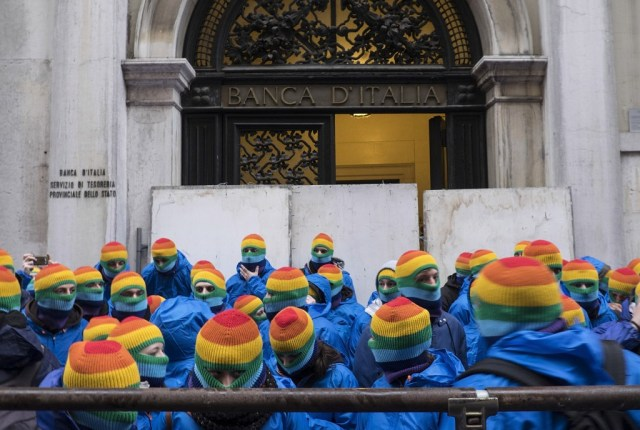 Activists wearing rainbow masks barricade italian bank