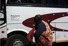 Zimbabwe national team coach Callisto Pasuwa (with blanket) seen here boarding a bus to Malawi last month for a match