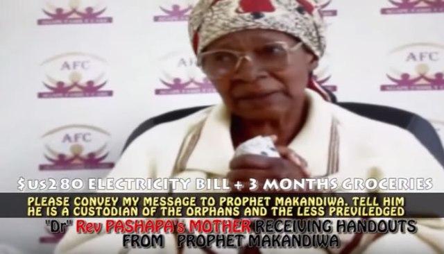 Gogo Miriam Pashapa receiving handouts from Emmanuel Makandiwa's church
