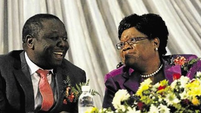 Morgan Tsvangirai seen here sharing a smile with Joice Mujuru who was then Vice President