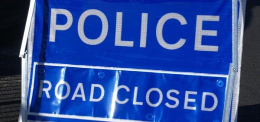 Police road closed sign