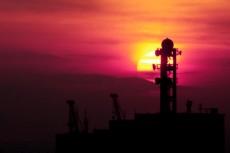 夕陽と鉄塔の写真素材