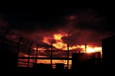 屋上と夕陽の写真素材