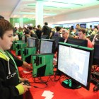 A young attendee plays some CoD: Ghosts awaiting the midnight launch.